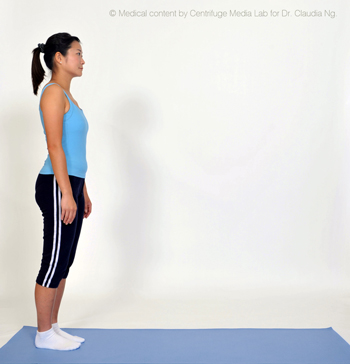 Stand at the end of the mat.  Tilt pelvis in.