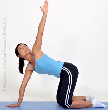 Place right hand in the middle as support.  Turn your body to the left with left arm reaching straight up.  Hold for 5 sec.