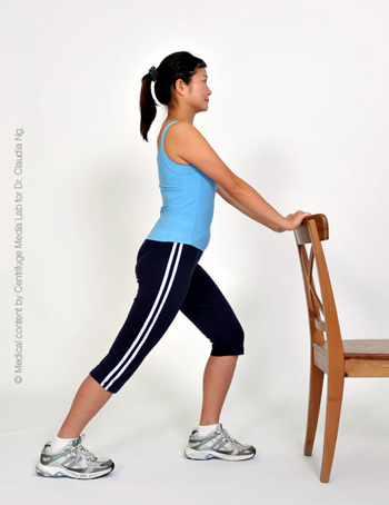 Standing with support, bend one leg in front and the other leg straight behind.  Make sure both feet are pointing straight ahead and the heel of the straight leg is touching the floor.  Feel stretch in the lower part of the straight leg and hold for 30 se