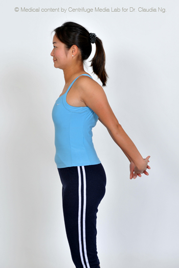 Keep your chin tucked in, open your chest and pull both arms outward and backwards.  Hold for 30 sec while taking deep breathes.